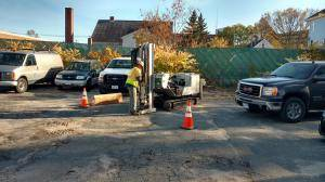 Probing in parking lot attached to 65 Hanover Street